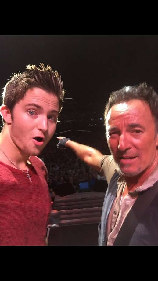Bruce Springsteen invited Matthew Aucoin, a Texas A&M student, on stage to sing a duet after noticing the poster he was holding on Sept. 9,  2016 in Philadelphia. Photo: Provided By Matthew Aucoin
