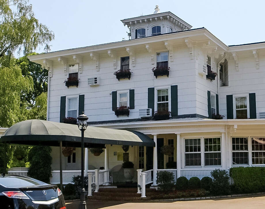 The exterior of Homestead Inn - Thomas Henkelmann in Greenwich, Conn, where four Star Chef Henkelmann was again featured in a top 100 restaurant list by OpenTable, an online avenue for foodies to book restaurant reservations and share reviews. Photo: Contributed Photo / Connecticut Post Contributed