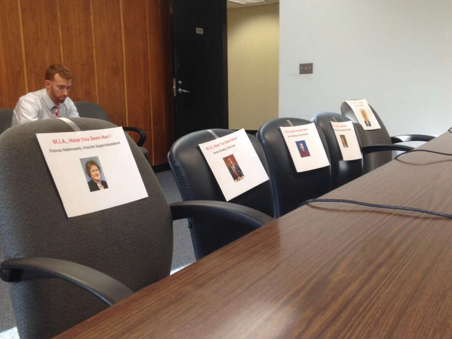 Signs pointing out missing board members placed at Bridgeport BOE finance committee meeting, Sept. 13, 2016 Photo: Linda Conner Lambeck / Linda Conner Lambeck