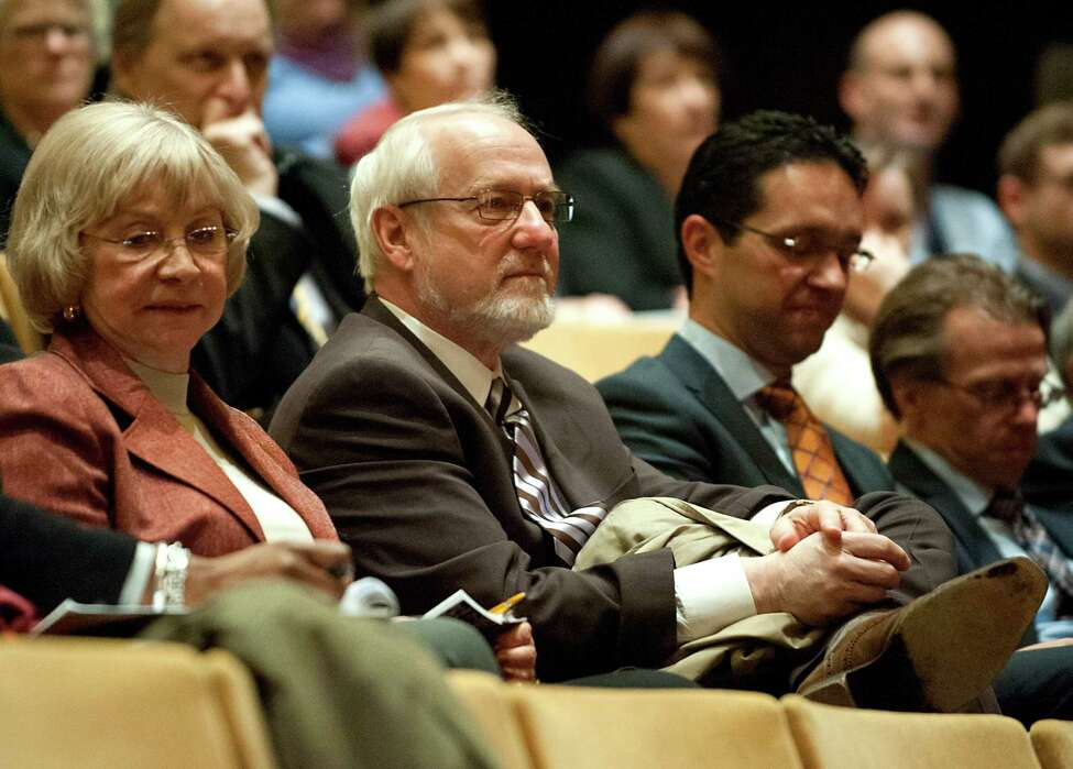 Senior Vice President for Academic Affairs and Provost at the University at Albany James R. Stellar, Ph.D., center, listens as President Robert Jones gives his spring address on the