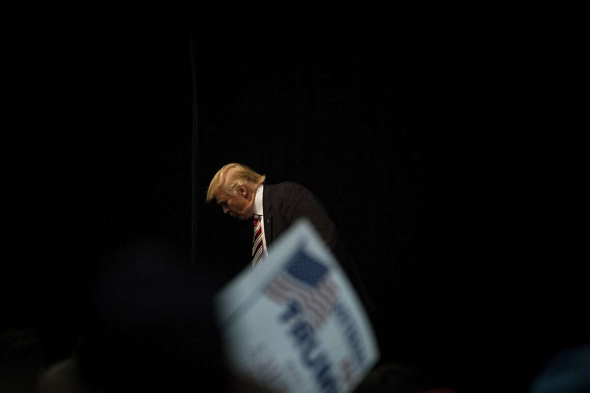 FILE-- Donald Trump, the Republican presidential nominee, exits the stage after speaking at a campaign event at the Seven Flags Event Center in Clive, Iowa, Sept. 13, 2016. Trump on Wednesday gave a small window into some of the results from his most recent physical examination in a taped appearance with the television celebrity Dr. Mehmet Oz. The quick run-through of results came after his aides had said he would, and then that he wouldn�t, broach the topic on the show. (Damon Winter/The New York Times)