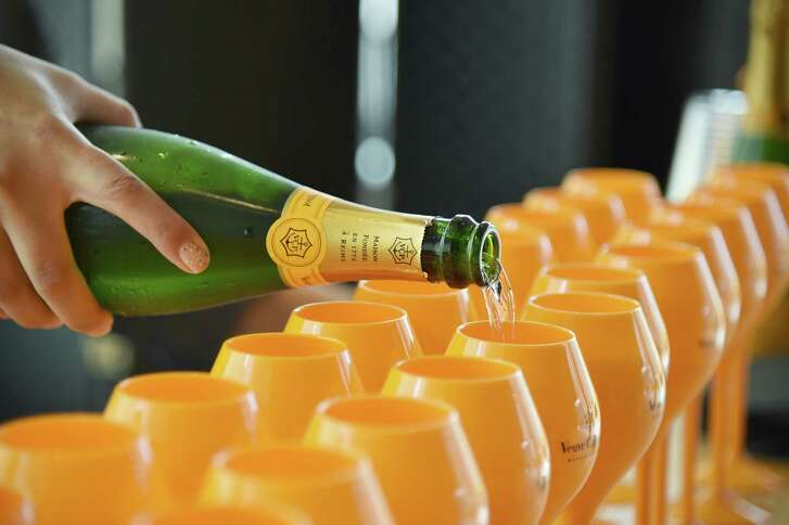 NEW YORK, NY - JUNE 04: Veuve Clicquot Champagne being poured during the New York Magazine and Veuve Clicquot Polo Classic viewing party at The Vine on June 4, 2016 in New York City.