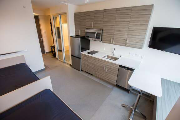 """One of the rooms that will resemble Panoramic Interests' micro units, on Wednesday, Sept. 14, 2016 in San Francisco, Calif. Panoramic Interests wants to build micro-units to be used as supportive housing for the homeless. The stacked units are made of metal shipping container-type boxes. They are being called """"Lego houses."""""""
