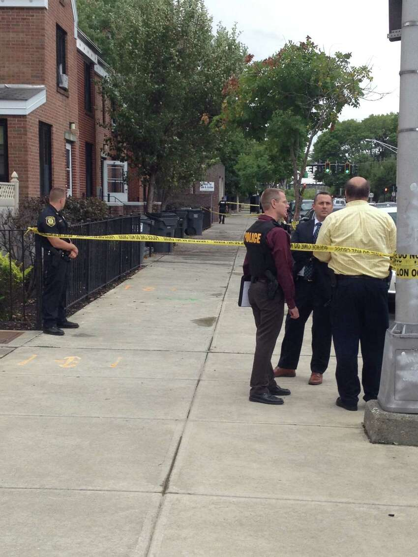 Albany police are at the scene of an incident on Green Street where an officer's gun went off while police took a bank robbery suspect into custody. (Brendan J. Lyons / Times Union)