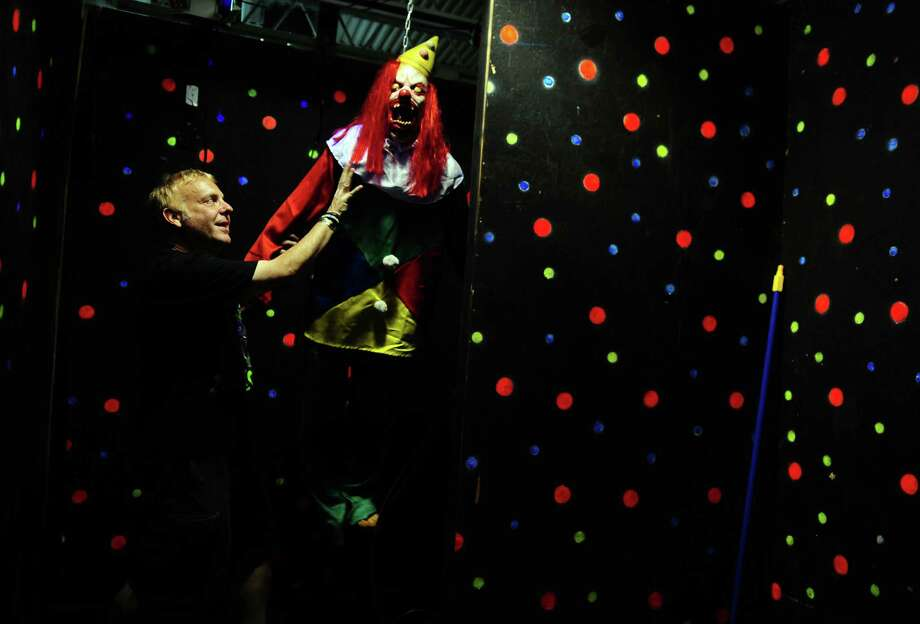 Charles Rosenay describes one of the scare spots at Fright Haven, a haunted attraction for Halloween, which is located in the former Balley's Fitness Center in Stratford Square Shopping Center in Stratford, Conn., on Tuesday Sept. 13, 2016. Fright Haven is being called CT's Greatest Indoor Haunted Attraction, with three separate haunted mazes. Photo: Christian Abraham / Hearst Connecticut Media / Connecticut Post