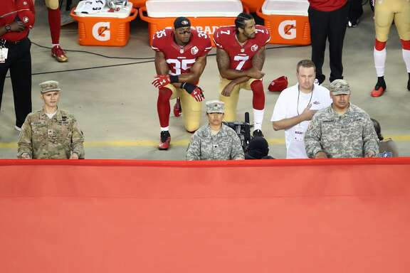 SANTA CLARA, CA - SEPTEMBER 12:  Colin Kaepernick #7 and Eric Reid #35 of the San Francisco 49ers kneel in protest during the national anthem prior to playing the Los Angeles Rams in their NFL game at Levi's Stadium on September 12, 2016 in Santa Clara, California.  (Photo by Ezra Shaw/Getty Images)