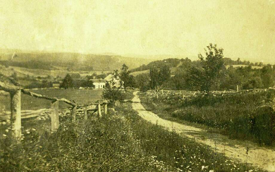 The home of Samuel Jay Nettleton at 44 Kielwasser Road in Washington is visible off the distance in this undated photograph of Kielwasser Road. Street names like Kielwasser and others will be the topic of discussion at the next meeting of Gunn Historical Museum's Washington History Club Sept. 19 at 10 a.m. at the Washington Senior Center in Bryan Plaza. For more information about the meeting, call 860-868-7756. Photo: Courtesy Of Gunn Historical Museum / The News-Times Contributed