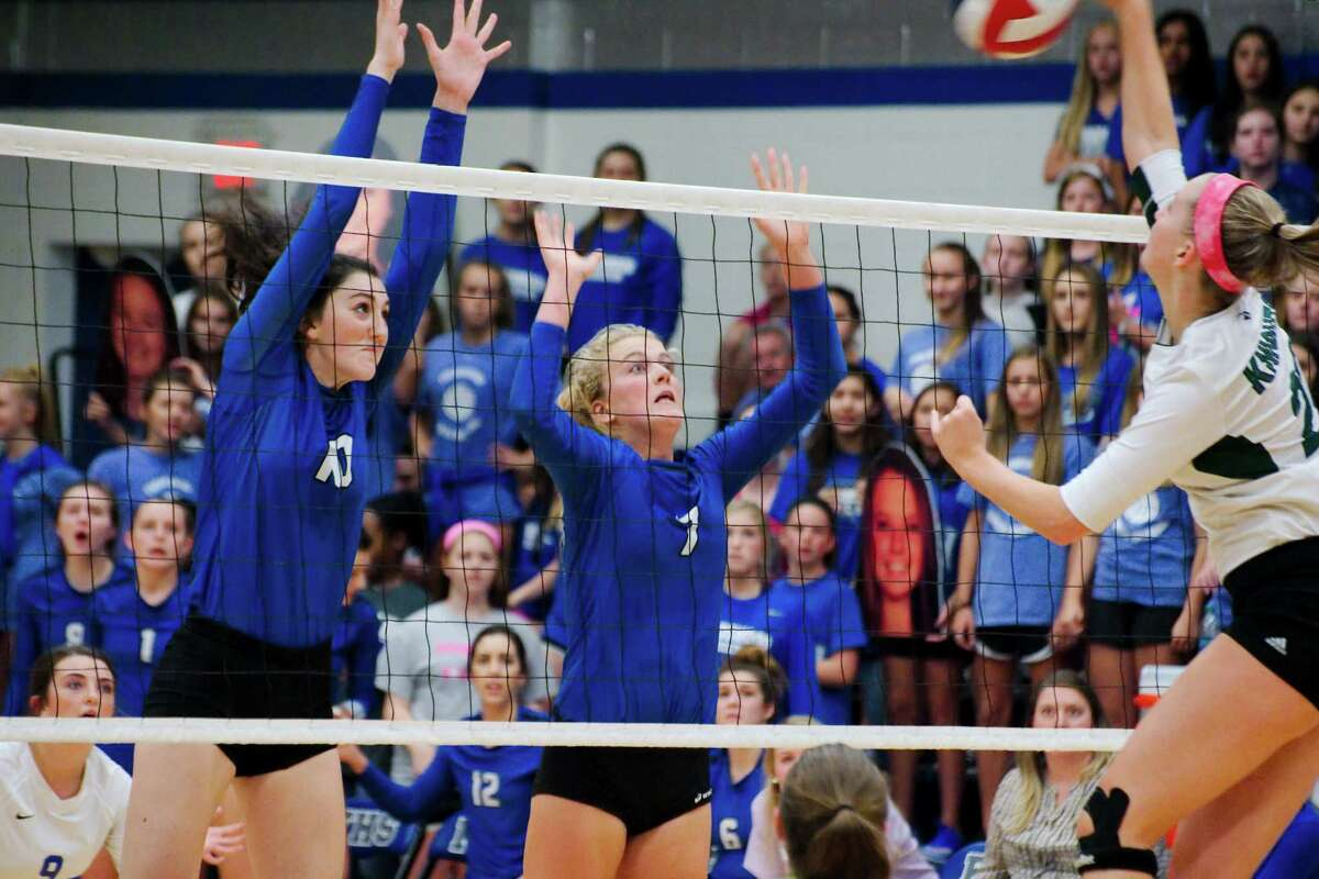 Sept. 13: Clear Falls def. Friendswood 25-23, 23-25, 28-26, 24-26, 15-12 Friendswood's McKenna Fridye (10) and Friendswood's Shannon Murphy (7) go high to block a shot by Clear Falls' Sophie Schaff (22) Tuesday, Sep. 13.