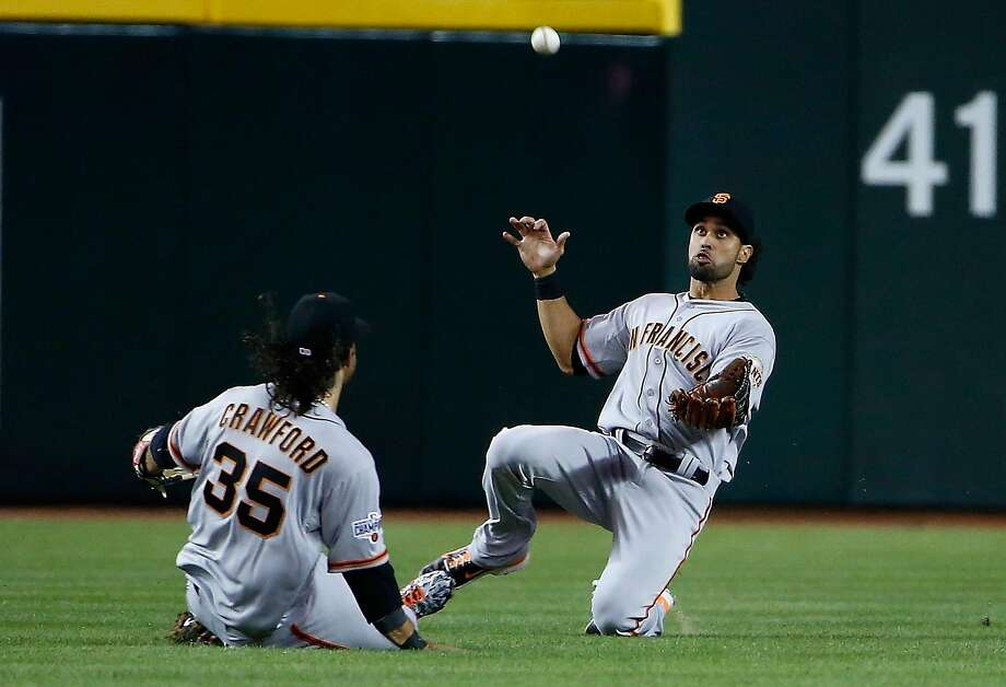 Angel Pagan makes a sliding catch in the 2015 opener at Chase Field in Phoenix. The Giants will open their 2017 season there on April 2. Photo: Christian Petersen, Getty Images