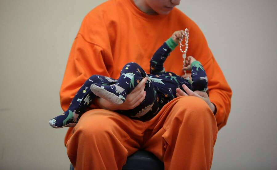 An inmate at County Jail #5 gazes at his son as he holds him in his arms during a Community Works One Family visit on Saturday, June 4, 2016 in San Francisco, California. Photo: Lea Suzuki, The Chronicle