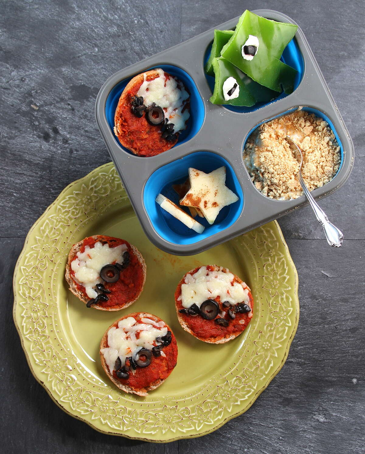 We have been busy getting ready to share a few lunch box ideas with deliciously fun ways to keep lunch filled with creative yum! These recipes are easy and can be used for afterschool snacks and/or party bites. This month, we captured the Pokemon phenomenon. We used mini bagels to create Pokeballs and green peppers to make metapods. Then we created a Sand Shrew-inspired parfait and Pikachu-inspired fruit stars for all kinds of energy. (Jodie Fitz)