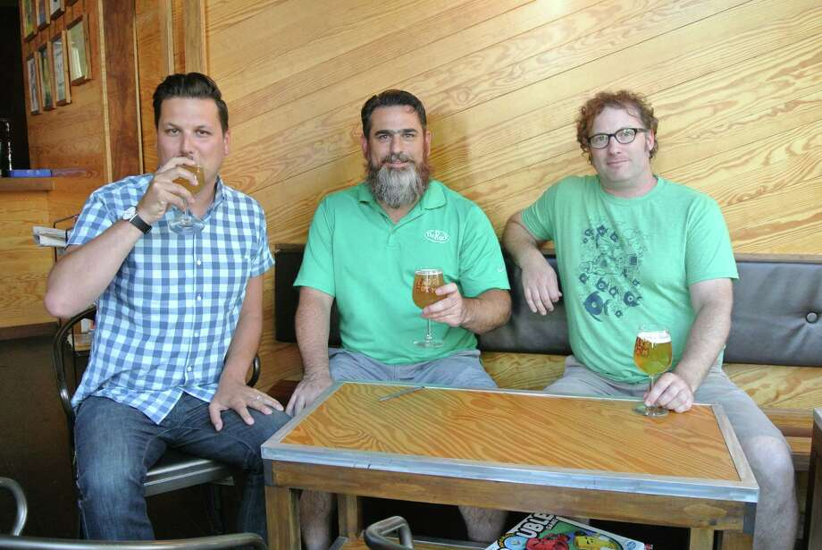 Frank Sicari, Dave Gardell, and Kevin Mullen, all members of the Troy Craft Beer Council, meet at Rare Form Brewing Company in Troy to discuss the upcoming Collar City Beer Invitational. (Deanna Fox)