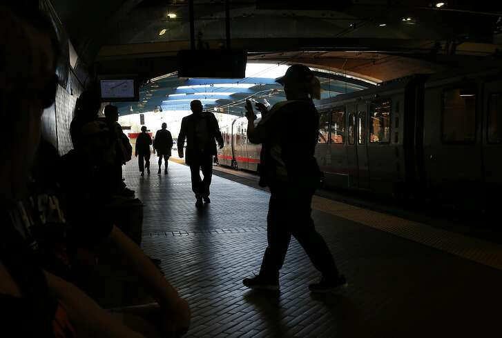 People mill about while waiting for the Muni train at the West Portal train station Sept. 14, 2016 in San Francisco, Calif.