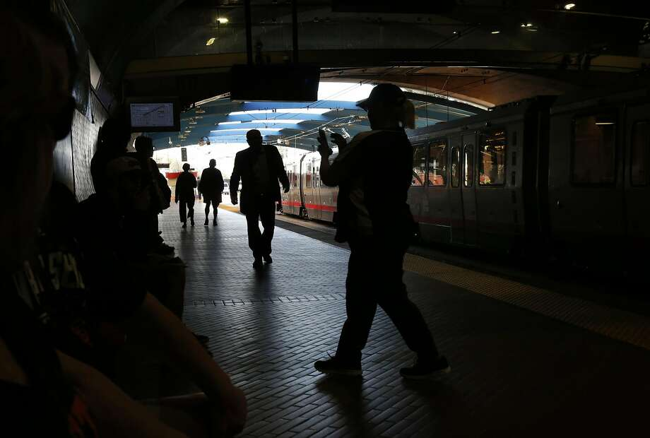Passengers wait for the Muni train at the West Portal Station in San Francisco. Photo: Leah Millis, The Chronicle