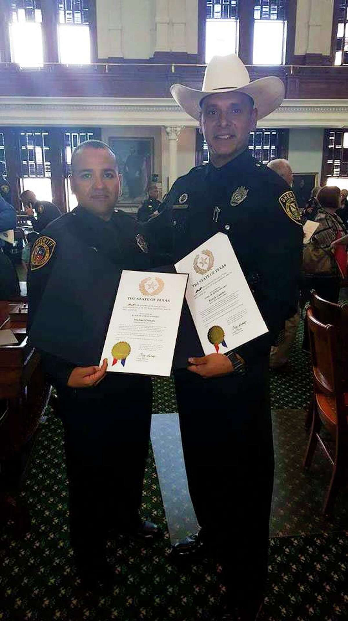 From left: Deputies Michael Donato and Joseph Canales were honored by Gov. Greg Abbott on Sept. 12, 2016, after being shot in the line of duty.