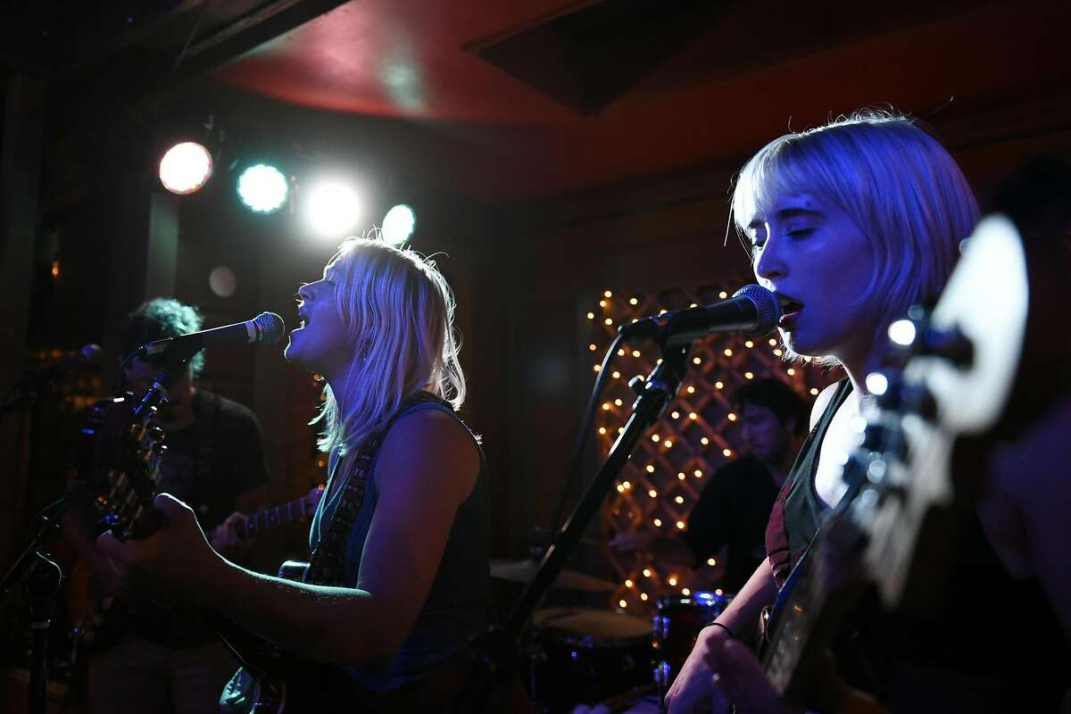 Katie Clover, left, and Alisa Saario of the band Cave Clove, perform at Sophia's Thai Kitchen in Davis, CA Thursday, September 8, 2016.