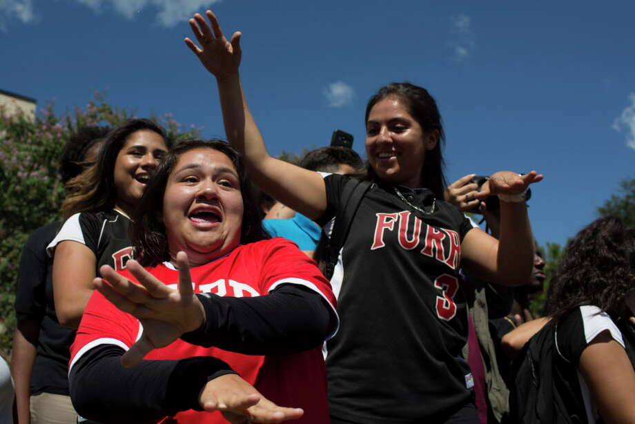 Deserae Valdez, cq, left, and Roxanne Morales, right, dance in celebration of the $10 million grant their school, Furr High School won Wednesday, Sept. 14, 2016. The grant is sponsored by Lauren Powell Jobs, the widow of Steve Jobs. Photo: Marie D. De Jesus / © 2016 Marie D. De Jesus