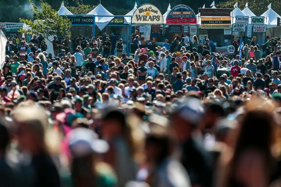 Fans gather to watch The Mavericks on the Banjo stage at Hardly Strictly Bluegrass on Friday, Oct. 2, 2015 in San Francisco, Calif.