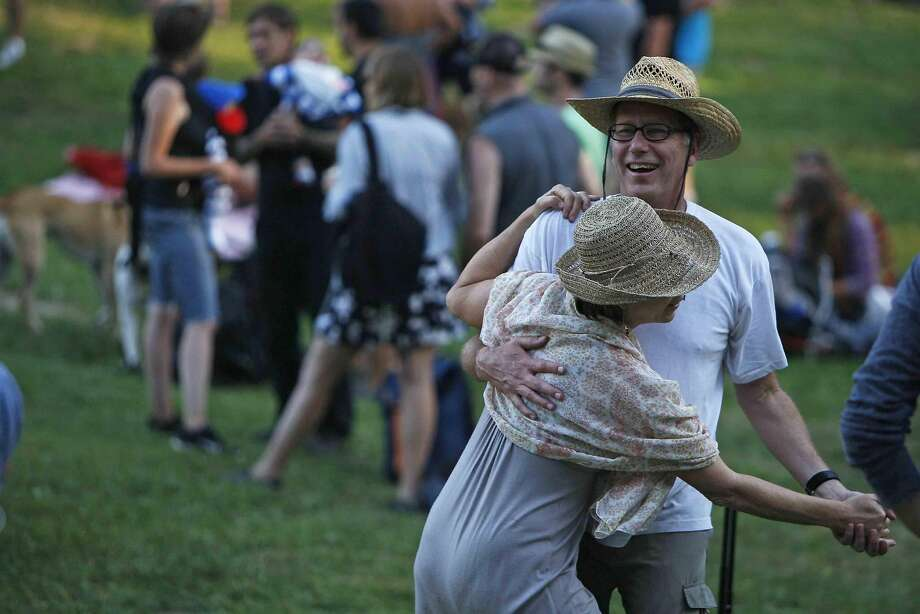 Marrita Hawryluk dances with Richard Chiles during the third day of the Hardly Strictly Bluegrass Festival in San Francisco's Golden Gate Park Sunday, October 5, 2014. Photo: Jessica Christian, The Chronicle