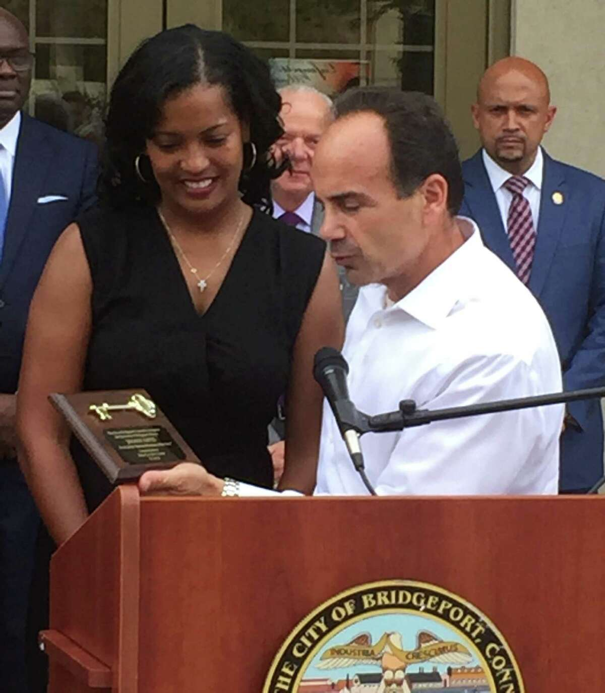 Bridgeport Mayor Joseph P. Ganim presents 2016 National Teacher of the Year, Jahana Hayes with a key to the city during a ceremony at City Hall on Wednesday, Sept. 14, 2016.