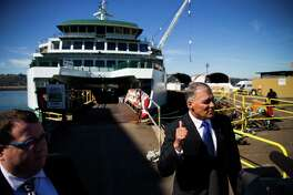 Washington Gov. Jay Inslee interviews after stepping off Washington State Ferries' new Olympic Class vessel, the Chimacum, following its christening ceremony at Vigor Industrial on Harbor Island, Wednesday, Sept. 14, 2016.  (GRANT HINDSLEY, seattlepi.com)