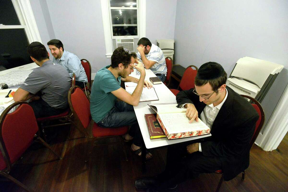 Evan Finkel of Stamford, center, and Yehuda Eisenberger of Monsey, NY, at right, study the Talmud in the new Stamford Torah Learning Center on Bedford Street in Stamford on Tuesday, Sept.13, 2016.