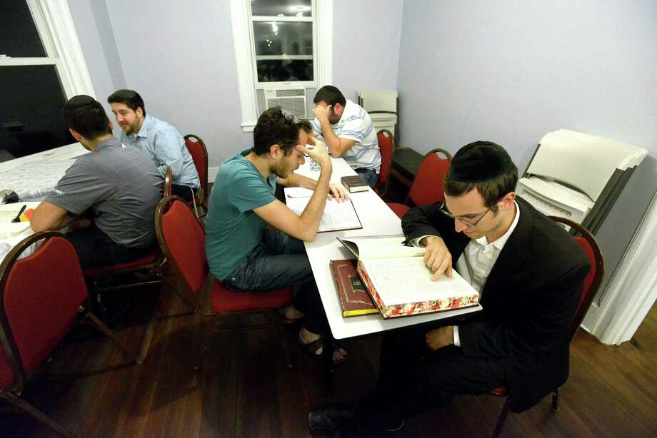 Evan Finkel of Stamford, center, and Yehuda Eisenberger of Monsey, NY, at right, study the Talmud  in the new Stamford Torah Learning Center on Bedford Street in Stamford on Tuesday, Sept.13, 2016. Photo: Matthew Brown / Hearst Connecticut Media / Stamford Advocate