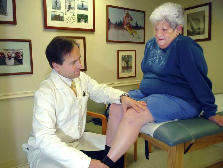 Cos Cob_021108_Joyce Summa, from Stamford, has Dr. Kevin Plancher check her artificial knees that he implanted for her 2 1/2 years ago.  Mrs. Summa says that the knees work well.  Helen Neafsey/staff photo Staff Photo Neafsey,Helen