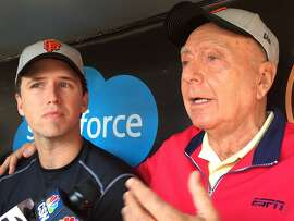 Buster Posey of the San Francisco Giants and ESPN basketball analyst Dick Vitale appear in the Giants' dugout at AT& Park after joining forces to fight pediatric cancer.