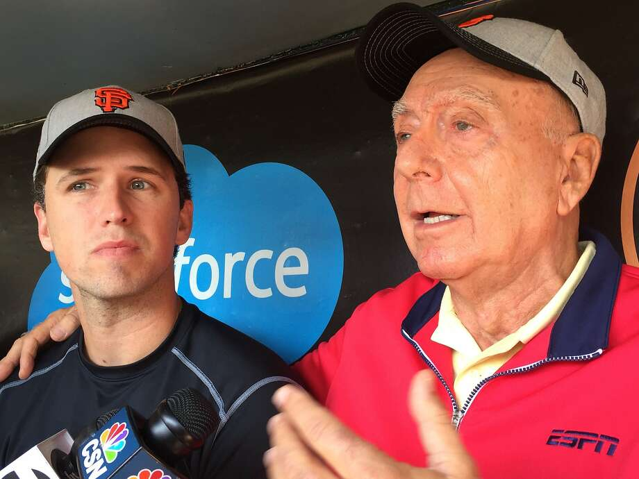 Buster Posey of the San Francisco Giants and ESPN basketball analyst Dick Vitale appear in the Giants' dugout at AT& Park after joining forces to fight pediatric cancer. Photo: John Shea