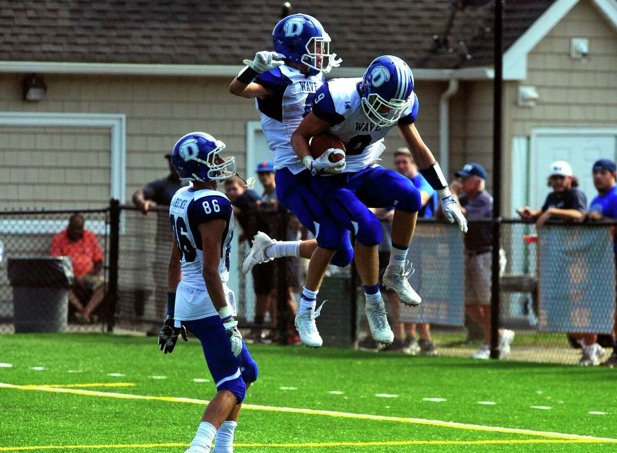 Darien's Finlay Collins celebrates with a teammate in the endzone after scoring a touchdown during football action against St. Joseph in Trumbull, Conn. on Saturday Sept. 10, 2016.