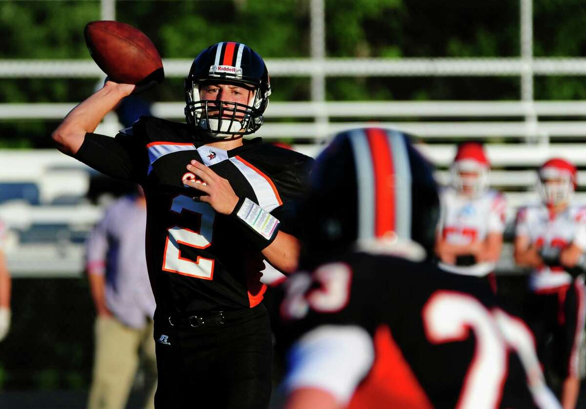 Shelton QB Dave Wells prepapres to pass the ball during scrimage action against Masuk in Shelton, Conn. on Tuesday, Aug. 30, 2016.