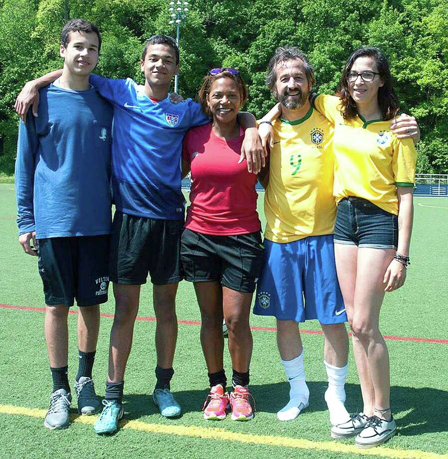 The Allers of family of Wilton, featuring sons, from left, Harrison and Chauncey, parents Carole and Andrew, and daughter Emily, post for a photo at Kristine Lilly Field in Wilton. Carole and Chauncey are currently both student-athletes at Western Connecticut State University. Photo: Contributed Photo / Hearst Connecticut Media / Norwalk Hour
