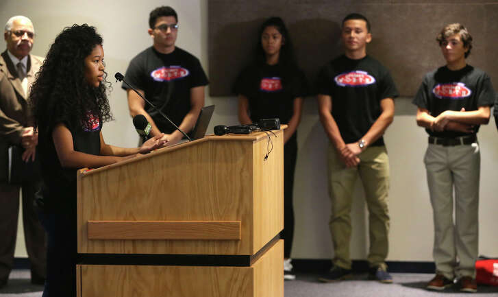 Reiana Fernandez,18, (at lectern) speaks at the Central Library on Wednesday during a news conference about declining teen pregnancy rates. Fernandez, a Project WORTH teen ambassador, spoke about data released by the San Antonio Metropolitan Health District.