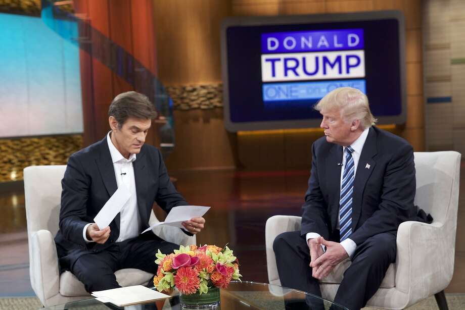 Donald Trump pulled two pieces of paper out of his coat pocket and handed them to TV personality Dr. Oz during his show. Photo: Associated Press