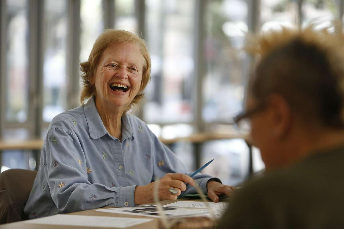 Betty Traynor (left) of San Francisco talks with Ginger Martin (right), community outreach worker Downtown San Francisco Senior Center and others during a Friends of Boeddeker Park meeting in the Boeddeker Park clubhouse on Wednesday, September 14, 2016 in San Francisco, California.