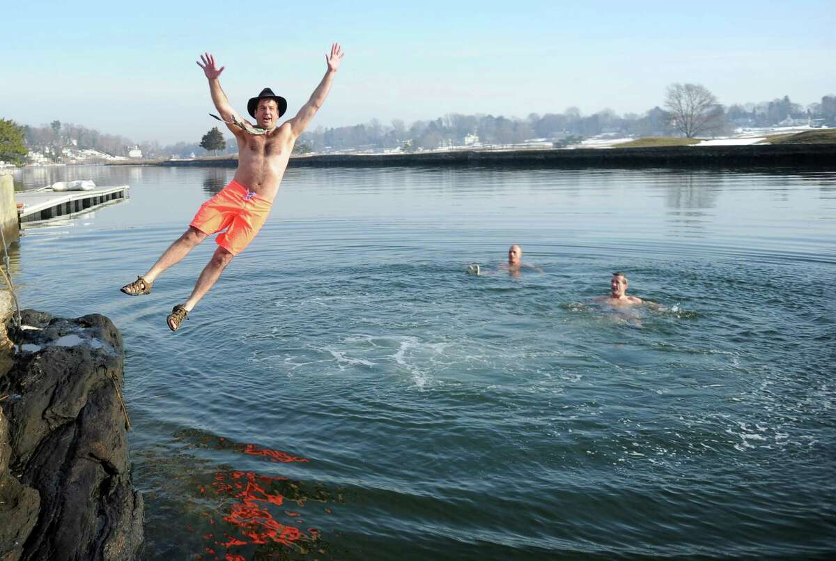 Bob Kaps jumps into Southport Harbor to benefit Shane DiGiovanna, who has the rare skin condition epidermolysis bullosa, on Saturday, January 1, 2011.