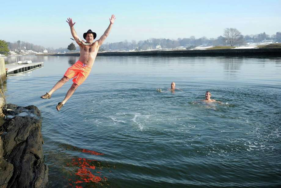 Bob Kaps jumps into Southport Harbor to benefit Shane DiGiovanna, who has the rare skin condition epidermolysis bullosa, on Saturday, January 1, 2011. Photo: Lindsay Niegelberg / ST / Connecticut Post
