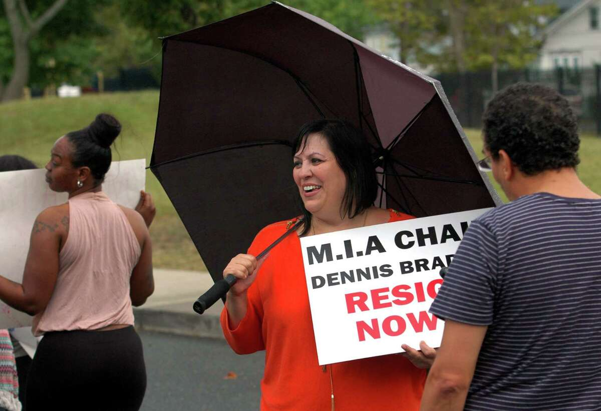 School board member Maria Periera, counter protests with her supporters against a group of parents who support her ouster from the board during a press conference and rally at Geraldine Johnson School in Bridgeport, Conn., on Wednesday Sept. 14, 2016. The parents, led by Parent Leader Jessica Martinez, are demanding the immediate resignation of Periera while Periera and her supporters were also at the rally to counter protest.