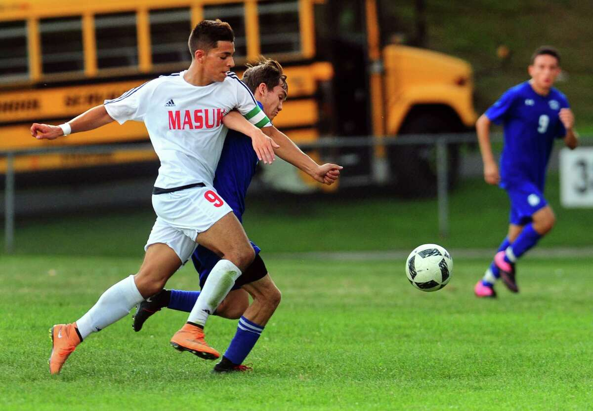 Masuk's Erik Naposki cuts off Bunnell's Alex Kells to intercept the ball during boys soccer action in Monroe, Conn., on Wednesday Sept. 14, 2016.