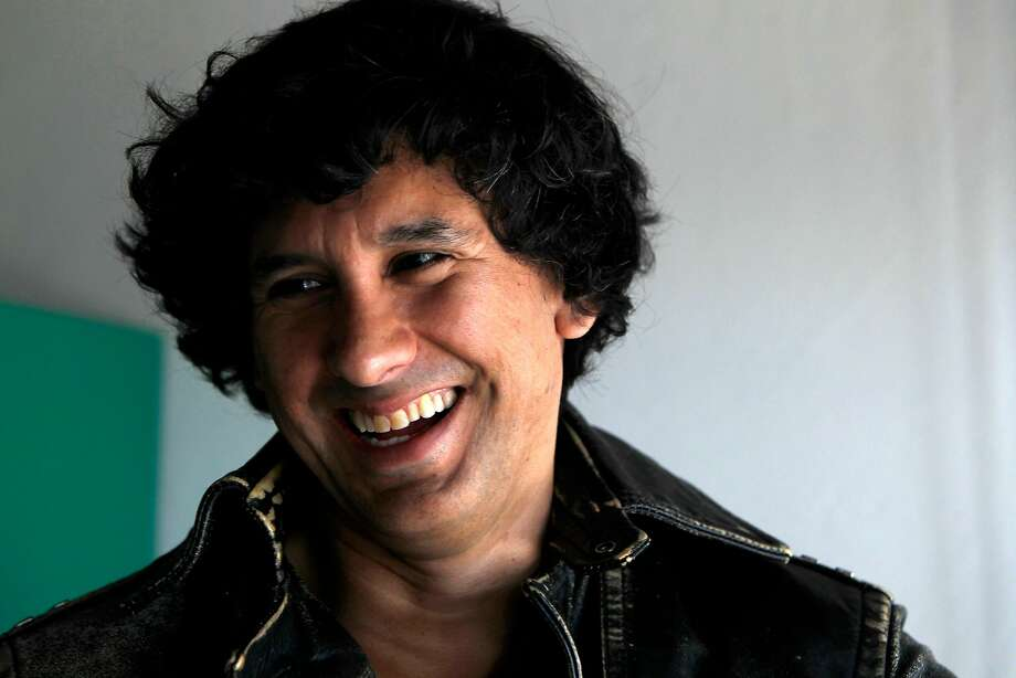"Mauro Javier Cardenas at his apartment in San Francisco, California on Wednesday, September 14,  2016.  Cardenas' first novel, ""The Revolutionaries Try Again,"" is set both in San Francisco and his native Ecuador. Photo: Gabriella Angotti-Jones, The Chronicle"