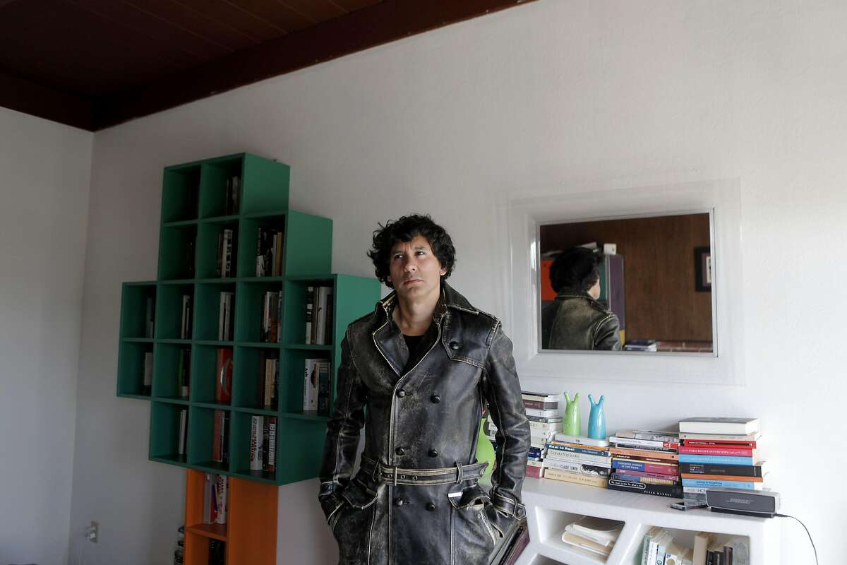 """Mauro Javier Cardenas at his apartment in San Francisco, California on Wednesday, September 14, 2016. Cardenas' first novel, """"The Revolutionaries Try Again,"""" is set both in San Francisco and his native Ecuador."""