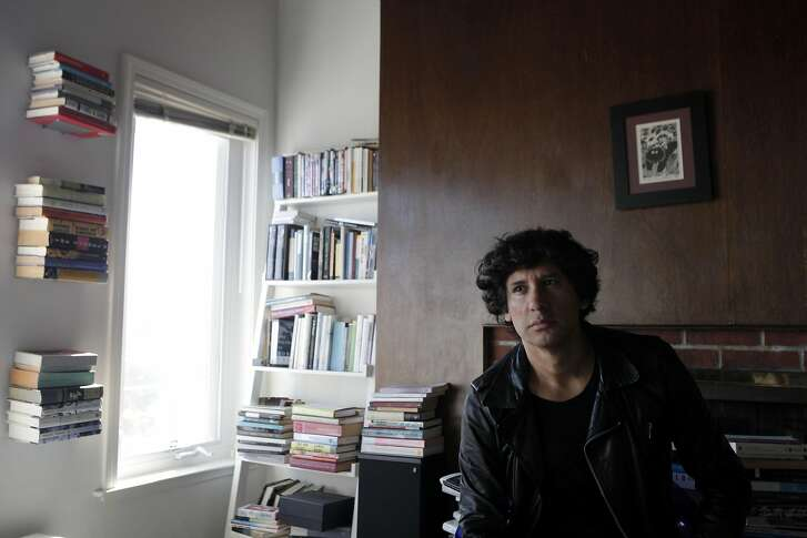 "Mauro Javier Cardenas at his apartment in San Francisco, California on Wednesday, September 14,  2016.  Cardenas' first novel, ""The Revolutionaries Try Again,"" is set both in San Francisco and his native Ecuador."