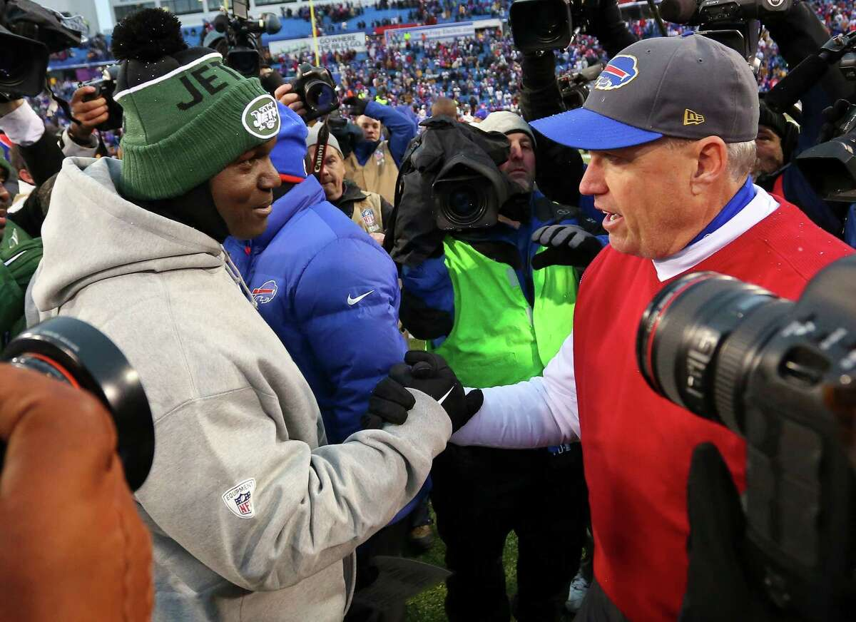 FILE - In this Jan. 3, 2016, New York Jets head coach Todd Bowles, left, and Buffalo Bills head coach Rex Ryan, right, shake hands after the Bills' 22-17 win in an NFL football game in Orchard Park, N.Y. The Jets are heading to Orchard Park for an AFC East showdown against the Bills on Thursday night. (AP Photo/Bill Wippert, File) ORG XMIT: NY182