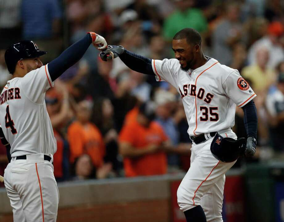 After beating the Rangers on Wednesday, Teoscar Hernandez (35), George Springer and the Astros head to Seattle for a three-game series against the second-place Mariners. Photo: Karen Warren, Houston Chronicle / 2016 Houston Chronicle