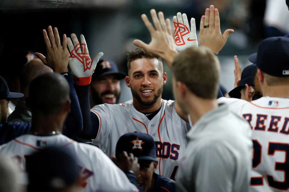 Houston Astros George Springer (4) celebrates his home run with teammates during the first inning of an MLB game at Minute Maid Park, Wednesday, Sept. 14, 2016 in Houston. Photo: Karen Warren, Houston Chronicle / 2016 Houston Chronicle