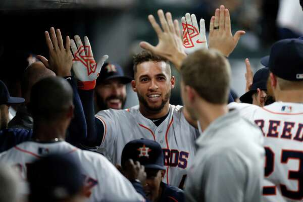 Houston Astros George Springer (4) celebrates his home run with teammates during the first inning of an MLB game at Minute Maid Park, Wednesday, Sept. 14, 2016 in Houston.