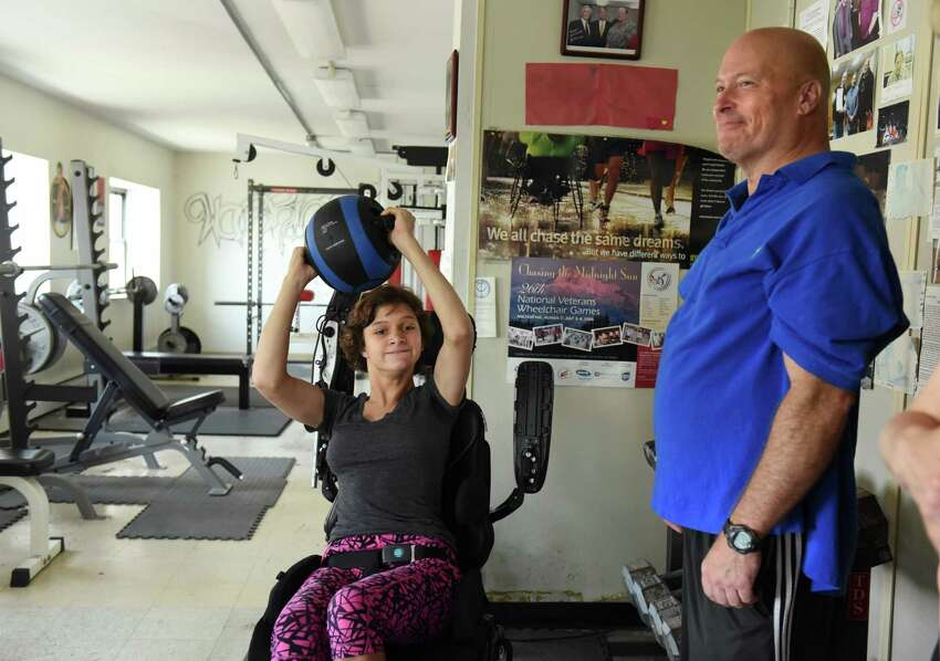 Trainer Ned Norton works with Center for Disabilities Services client Melanie Stier, 15, of Germantown on Thursday, Sept. 1, 2016 in Albany, N.Y. Norton does workouts for people with developmental disabilities and other disabilities as well as people who have just had a rough road, like wounded vets and ex-cons. (Lori Van Buren / Times Union)