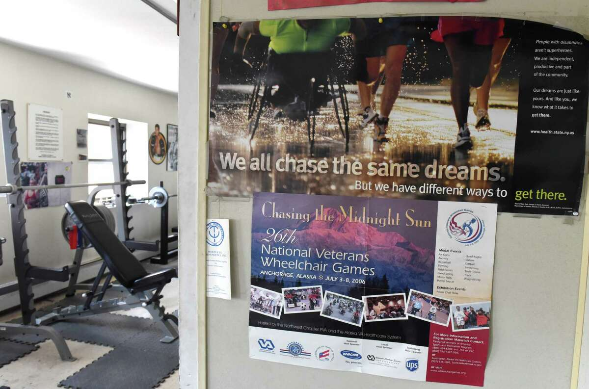Posters hang on the wall at trainer Ned Norton's gym on Thursday, Sept. 1, 2016 in Albany, N.Y. Norton does workouts for people with developmental disabilities and other disabilities as well as people who have just had a rough road, like wounded vets and ex-cons. (Lori Van Buren / Times Union)