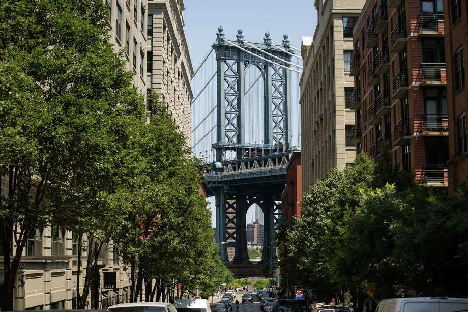 NEW YORK, NY - JUNE 24: A view of the Manhattan Bridge in the DUMBO neighborhood on June 24, 2016 in the Brooklyn borough of New York City. According to a survey released on Thursday by real-estate firm RealtyTrac, Brooklyn ranked as the most unaffordable place to live in the United States. (Photo by Drew Angerer/Getty Images) Photo: Drew Angerer / 2016 Getty Images
